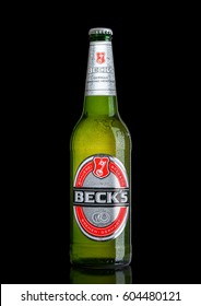 LONDON, UK - MARCH 15, 2017: Bottle of Becks beer on black background with reflection. Becks brewery was founded in 1873 in Bremen, Germany.