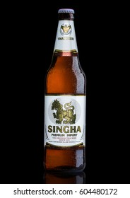 LONDON, UK - MARCH 15, 2017: Bottle of Singha beer on black background , Singha beer is most popular in thailand , Rayong , Thailand