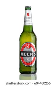 LONDON, UK - MARCH 15, 2017: Bottle of Becks beer on white background with reflection. Becks brewery was founded in 1873 in Bremen, Germany.