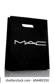 LONDON, UK - MARCH 15, 2017:  MAC Cosmetics paper shopping gift bag  white background. MAC Cosmetics was founded in Toronto, Ontario, Canada in 1984.