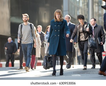 London, UK - March 15, 2017: Lots of office people walking in the city of London. Modern busy business life