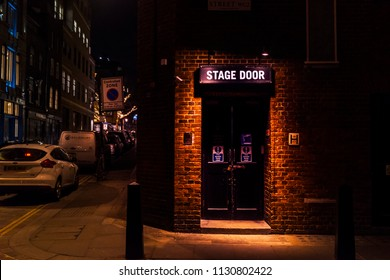London, UK - March 15 2018: Stage door of the Cambridge theatre on Shelton Street, in Covent Garden. Night scene and neon colors LONDON, UK