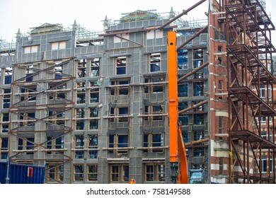 London, UK - March 16, 2017: Building construction site in the centre of London. Modern technology of renovation, saving the old historical facade and total build inside.