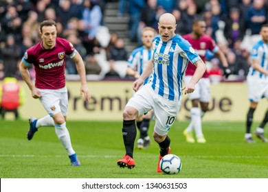 London, UK - march 16 2019: Aaron Mooy of Huddersfield Town  during the Premier League match between West Ham United and Huddersfield Town at the London Stadium, Queen Elizabeth Olympic Park
