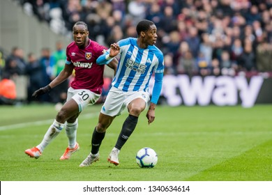 London, UK - march 16 2019: Terence Kongolo of Huddersfield Town  during the Premier League match between West Ham United and Huddersfield Town at the London Stadium, Queen Elizabeth Olympic Park