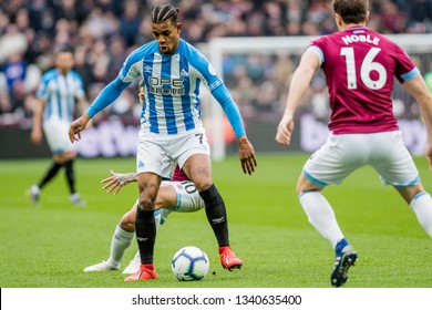 London, UK - march 16 2019: Juninho Bacuna of Huddersfield Town  during the Premier League match between West Ham United and Huddersfield Town at the London Stadium, Queen Elizabeth Olympic Park
