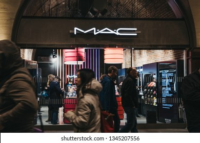London, UK - March 16, 2019: People walking past the MAC shop inside London bridge rail station, the UK's fourth busiest station has recently undergone a total modernisation.