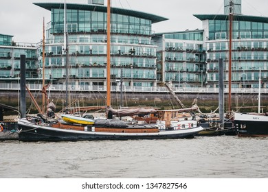 London, UK - March 16, 2019: View of  Hermitage Community Moorings in Wapping by the modern blocks of flats from River Thames, London. Real estate in London is amongst the most expensive in the world.