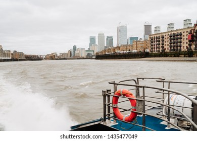London, UK - March 16, 2019; Canary Wharf buildings view from the River bus boat. Thames Clippers offer a fast and frequent service with departures from major London piers .