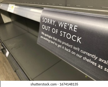 London, UK - March 16, 2020: Out of Stock sign in a supermarket shelf. Panic buying and stockpiling during the coronavirus crisis