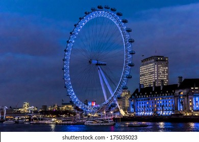 LONDON, UK - MARCH 17, 2013: View of the London Eye at evening. London Eye - a famous tourist attraction over river Thames in the capital city London.