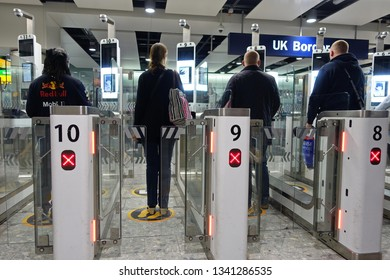 London, UK - March 17, 2019: Air travelers pass through automated passport border control gates at Heathrow Airport. The UK Border Force is contingency planning on the possibility of a no deal Brexit.