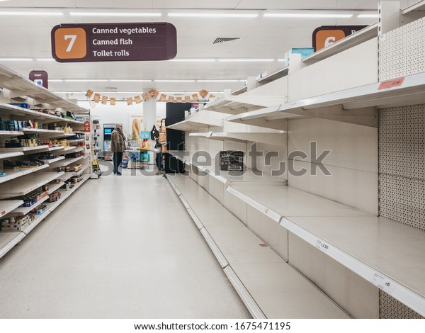 London, UK - March 17, 2020: Empty shelves in canned goods and toilet paper aisle of Sainsburys supermarket in Golders Green, London, as people stock up due to Coronavirus threat.