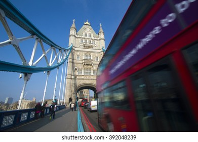 LONDON, UK - MARCH 18, 2015 : Tower Bridge and the famous red bus on the bridge,18  March 2015, in London.