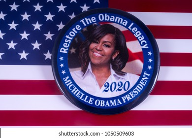 LONDON, UK - MARCH 18TH 2018: A Michelle Obama badge over the USA flag, symbolizing her potential candidacy to run for President in 2020, taken on 18th March 2018.