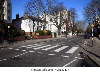 London, UK, March 19, 2011 : The  famous zebra  crossing in Abbey Road were the Beatles were photographed for the album Abbey Road, with Abbey Road studios in the background
