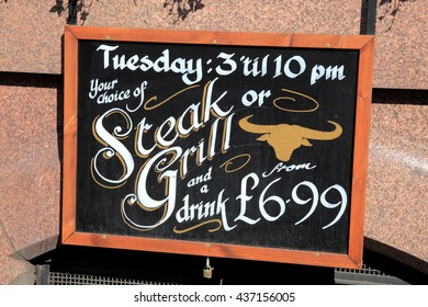 London, UK, March 19 2011 - Steak & Grill sign outside a London fast food restaurant