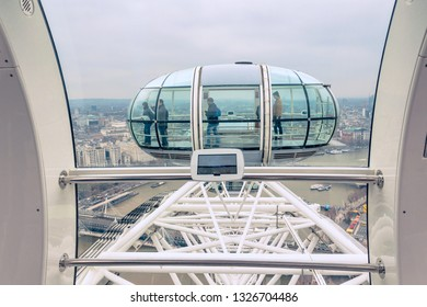 LONDON, UK -MARCH 19 2015: London Eye over Thames River. It is Europe's tallest Ferris wheel and the most popular paid tourist attraction in UK.