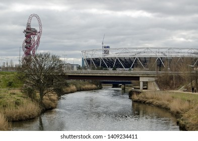 LONDON, UK - MARCH 19, 2016:  View along the River Lea towards the London Stadium and Orbit structure in Queen Elizabeth Olympic Park, Stratford.