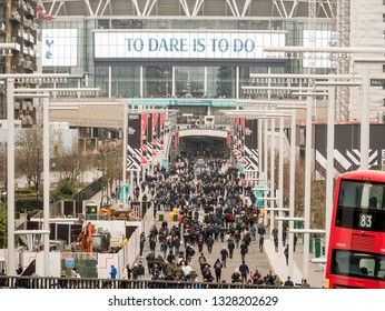 London, UK - March 2 2019: panoramic view outside of the wembley stadium while people go to see a sporting event.