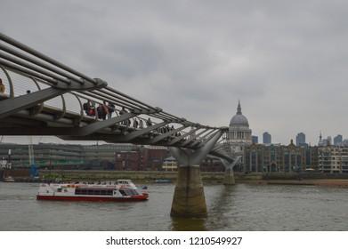 London, UK - March 2015: Millenium Bridge and Saint Paul Cathedral