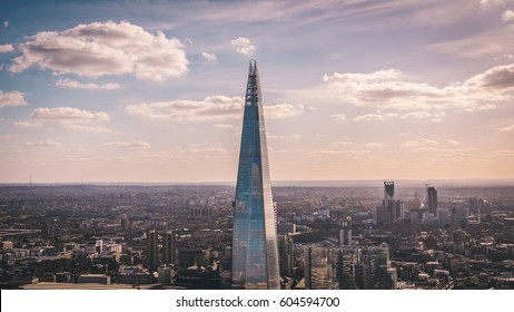 LONDON, UK - MARCH, 2016: Stunning panorama view over the London cityscape and The Shard. The Shard, also referred to as the Shard of Glass is a 95-storey skyscraper in Southwark, London.