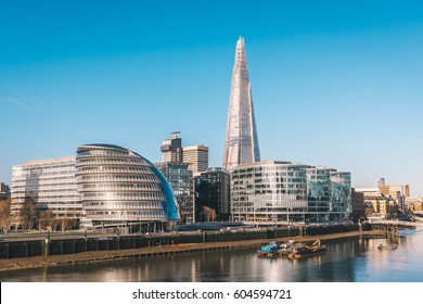 LONDON, UK - MARCH, 2016: View from the Tower Bridge over the river Thames, London City Hall and The Shard at sunny day.