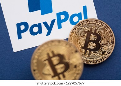 LONDON, UK - March 2021: Bitcoin cryptocurrency on a paypal online payment logo