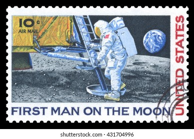 London, UK, March 22, 2012 - Vintage 1969 United States of America cancelled postage stamp  commemorating the first man on the moon