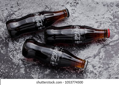 LONDON, UK -MARCH 22, 2018: Glass bottles of Classic Coca cola soda drink with diet and zero cola on stone backgtound.