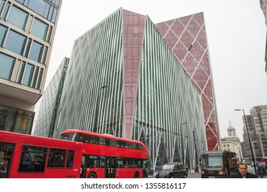 LONDON, UK - MARCH 22, 2019: People walking on the busy streets of London in the financial district, home of modern skyscrappers and office buildings