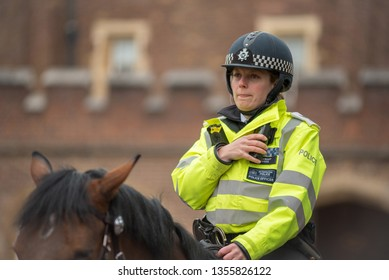 LONDON, UK - MARCH 22, 2019: Policewoman from the Metropolitan Police Mounted Branch riding her horse while patrolling in London