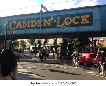 London, uk - March 22 2019: Camden Lock train famous landmark bridge with traffic going under stock, photo, photograph, picture, image,