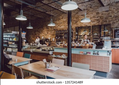 London, UK - March 23, 2019: Interior of the Camden Grocer, a luxury deli and cafe in Camden's Stables Market, London, UK.