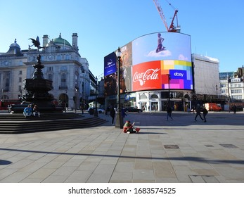 London / UK - March 23rd 2020: London's normally busy Piccadilly Circus, a popular tourist destination is nearly empty as people are told to  self isolate during the COVID-19 coronavirus