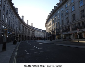 London / UK - March 23rd 2020: London's normally busy shopping area Oxford Circus, Oxford Street and Regents Street are nearly empty as people are told to  self isolate during the COVID-19 coronavirus
