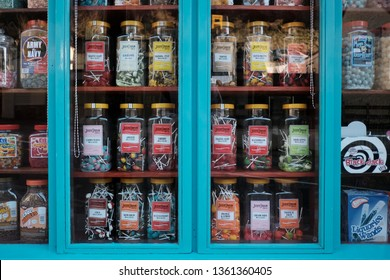 London, UK - March 24, 2019: Sweets and candy in jars are seen in a shop window.