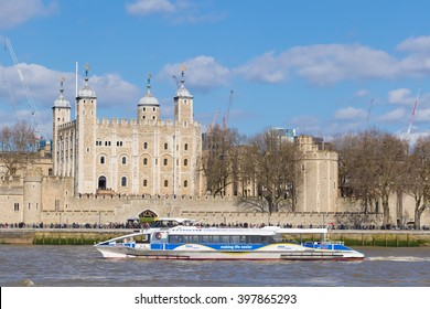 LONDON, UK - MARCH 25, 2016: Tourist boat passes The Tower of London