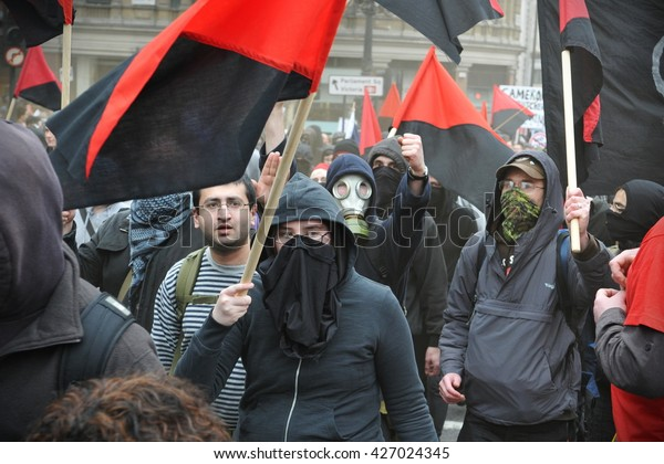 London, UK - March 26, 2011: A breakaway group of anarchist protesters march through the streets of the British capital during a large anti cuts rally.