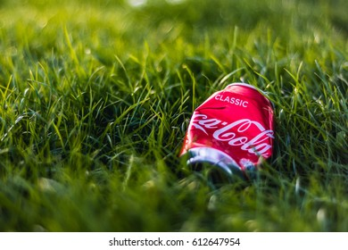 London, UK - March 26, 2017: A can of Coca-cola on green grass in a park in London