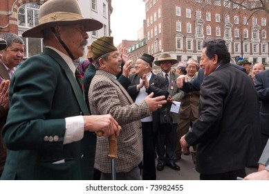 LONDON, UK- MARCH 26:Retired Gurkha soldiers break into song and dance before joining the TUC march against Government cuts. March 26, 2011 in London UK.