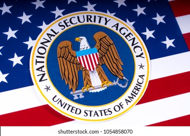 LONDON, UK - MARCH 26TH 2018: The symbol of the National Security Agency portrayed with the US flag, on 26th March 2018. The NSA is a national-level intelligence agency of the US Department of Defense