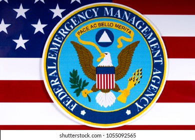 LONDON, UK - MARCH 26TH 2018: The symbol of the Federal Emergency Management Agency portrayed with the US flag, on 26th March 2018.  FEMA is an agency of the US Department of Homeland Security.