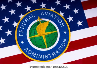 LONDON, UK - MARCH 26TH 2018: The symbol of the Federal Aviation Administration portrayed with the US flag, on 26th March 2018. The FAA is a national authority with powers to regulate civil aviation.
