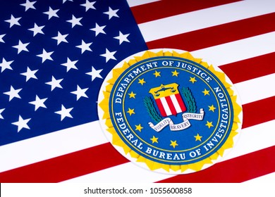 LONDON, UK - MARCH 26TH 2018: The seal of the Federal Bureau of Investigation with the US flag, on 26th March 2018. The FBI is the domestic intelligence and security service of the US.