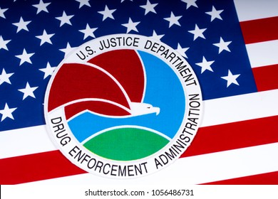 LONDON, UK - MARCH 27TH 2018: The seal or symbol of the Drug Enforcement Administration of the US Justice Department, portrayed with the USA flag, on 27th March 2018.