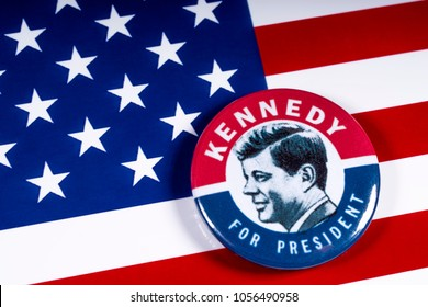 LONDON, UK - MARCH 27TH 2018: A Kennedy For President badge pictured over the USA Flag, on 27th March 2018.  John F Kennedy was the 35th President of the United States of America.