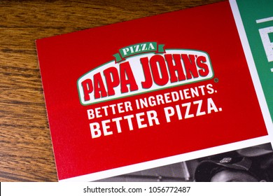 LONDON, UK - MARCH 27TH 2018: A close-up of the Papa Johns Pizza logo on a menu leaflet, on 27th March 2018.  Papa John's Pizza is an American restaurant franchise company.