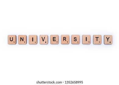 London, UK - March 27th 2019: The word UNIVERSITY, spelt with wooden letter tiles on a white background.
