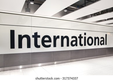 LONDON, UK - MARCH 28, 2015: International arrivals sign. Interior of  Heathrow airport Terminal 5. New building